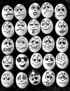 White eggs and many funny faces Stock Photo