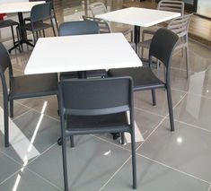 This is the Anthracite Grey Riva Side Chair and the Taupe Costa Side Chair at the back.
