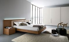 pallet bed frame by elegance oak wood floating platform bed in natural color combine cream fur rug great wooden bed idea on bedroom galleries Bedroom Furniture Sets, Bedroom Sets, Furniture Design, Glass Furniture, Cozy Bedroom, Couch Furniture, White Bedroom, Master Bedroom, Contemporary Bedroom