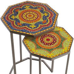 When you're short on table space, Celia is at your service. Our two-piece table set is handcrafted with colorful mosaic tops and hand-forged iron bases. Nesting neatly together, this duo has a special talent: Saving space and coming to your aid when you need a few extra tables for entertaining.