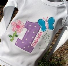 Ally's 1st Birthday Onesie she wore. Matched her hugs and stitches theme.