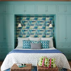 Highlight architectural elements by dousing them in standout shades. In this Ponte Vedra Beach, Florida, guest room, cool blue-green cabinetry adds a Caribbean punch to the room's lighthearted mix of playful patterns and breezy blues, plus it offers plent