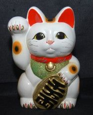 "Maneki Neko (Japanese: 招き猫, literally ""beckoning cat"") --To be seen outside every restaurant in Japan."