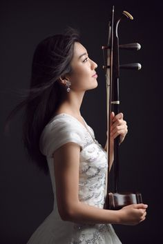 """Chinese musical instrument """"erhu"""". Artistic conception of Erhu finds expression mainly in the leisure in performing and in the tranquility of timbre."""