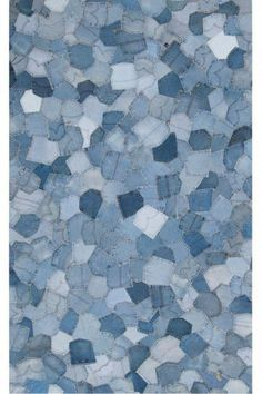 This rug is denim--made out of old jeans pockets! Would be neat in a family room or little boy's room!
