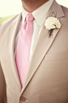 For the groom, forget the gray suit with the Pink tie, and try something new and different. Combine a cream jacket with a White shirt and a Pink polka dot tie. This will make the groom look flawless.