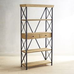 The rustic industrial-style Metro Bookcase offers modern minimalism with a retro flair. Its richly grained, kiln-dried hardwood coordinates with a square, metal frame, and cross-brace end panels provide maximum stability. Featuring four large shelves, including one with two roomy drawers, it's an ideal focal piece for any home office.