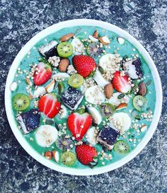 This morning's smoothie bowl ✖️4 frozen bananas, 2 passionfruit, 1 kiwifruit, 1/2 tbsp chia seeds, 1 tbsp maple syrup, 2 tsp @tropeaka ultra cleanse green powder (use 'smoothie20' for 20% their range! Love this brand so much), 1/4 tsp spirulina, 1-2 cups of almond milk BLEND Topped with fresh strawberries, kiwiberries, @thesourcebulkfoods almonds + pepitas + buckinis & @thecleantreatsfactory mint slices (that I cut up into bite sizes pieces and keep in my freezer) ❤️