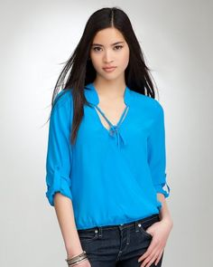 """Bebe Bubble Hem Surplice Tie Silk Top METHYL BLUE Size Small     Self-tie at neckline, cuffed sleeves, and elastic hem make this bebe top a luxurious go-to. Try it with an embellished skirt and layered bangles for an after-dark look. Center back to hem: 22"""""""".  $89.00"""