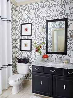 When your existing vanity cabinet offers good storage, nice lines, and sturdy construction, renew the look with a fresh coat of paint or stain. For a previously stained cabinet, sand off the old finish and apply updated stain color. You should also sand the gloss off a previously painted cabinet and smooth out any damage with filler, and then apply a coat of primer. Finish with a topcoat of color.