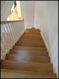 Painted stairs with blackbutt treads, risers and handrails