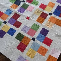 Custom machine quilting on a 4 patch variation quilt. I just love how quilting can add so much detail to an easy quilt pattern.