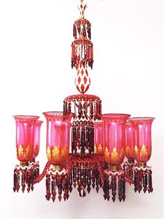 A RED, WHITE AND GILT GLASS OVERLAY CHANDELIER BY OSLER