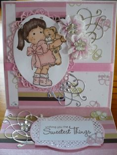 Easel card. I made the flowers by gathering a bit of lace then added bling. AlisonB