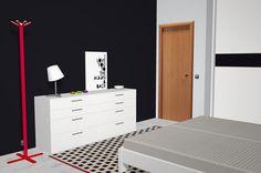 Vista general del mueble de cajones en color blanco de la habitación de matrimonio