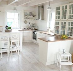 Grey floor, wood countertop, white cabinets for white kitchen interior design Grey Wood Floors, Grey Flooring, Kitchen Flooring, Kitchen Backsplash, Wood Kitchen Countertops, Countertop Decor, Kitchen Fixtures, White Shaker Cabinets, White Kitchen Cabinets