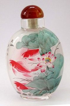 Chinese (Inside) Hand Painted Lotuses Fish Snuff Bottle - even though its a snuff bottle.. wow.. amazing. I believe this is made of glass?