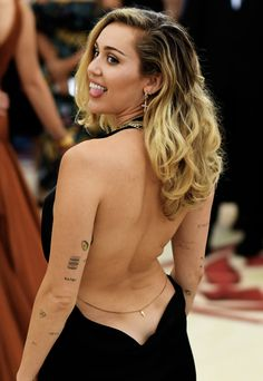 Miley Cyrus attends 2018 MET Gala Heavenly Bodies: Fashion & The Catholic Imagination Costume Institute Gala in New York on May 7th, 2018