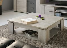 Make a modern statement in your living room by decorating it with the Parisot Travis Coffee Table . This square coffee table features a gray finish that. Furniture, Table Design, Livingroom Layout, Dining Table, Solid Wood Coffee Table, Table, Cool Coffee Tables, Brown Table, Coffee Table