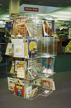 Library display shelving for books, paperbacks, newspapers, periodicals, A/V, audio & video tapes.  Our modular acrylic shelving used in thousands of libraries and book stores in USA & Canada