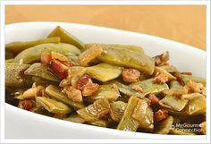Italian Green Beans with Pancetta and Braised Garlic: Braised garlic and pancetta flavor this easy, make-ahead side dish made with Italian-style flat (or regular) green beans.