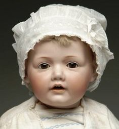 """A Kestner """"Hilda"""" Character Baby #237 doll with brown glass sleep eyes, and an open mouth with two upper teeth, on its original five-piece bent-limb body; ..."""