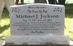 A granite headstone at the burial site at Woodlawn Cemetery in Detroit for the mementos left for singer Michael Jackson outside the Motown Historical Museum