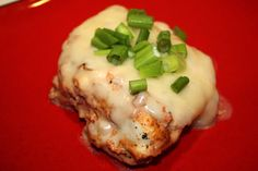 SALSA CHICKEN   4 boneless chicken breasts   2 teaspoons Seasoning for Tacos   1 cup salsa   1/2 cup sour cream   4 ounces Monterey jack cheese, shredded   Chopped green onions, for garnish, optional