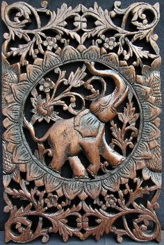 carved wooden teak panel showing an elephant