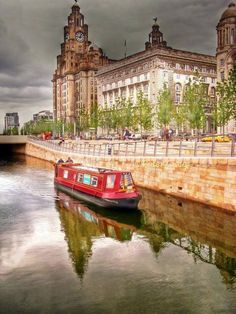 Canal barge passing Liver Buildings - Photography by Peter Craig.  https://fbcdn-sphotos-h-a.akamaihd.net/hphotos-ak-ash3/1017329_10201441114089721_1103058162_n.jpg