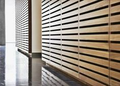 Here's One Alternative To Boring Drywall: Wood Wall Paneling: Horizontal Strips of Wood Create Paneling In Hallway