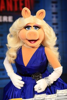 """Last night, style icon Miss Piggy wore a Royal Blue Check Silk Taffeta Cassock Dress, from Vivienne Westwood Couture, for the World Premiere of """"MUPPETS MOST WANTED"""" in Hollywood.  Miss Piggy also called upon Vivienne Westwood to design key wardrobe selections for this Disney film, which hits U.S. theatres 21 March 2014 and in the U.K. on 28 March 2014.  Vivienne Westwood Couture is available from our boutique at 6 Davies Street in London."""