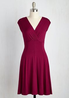 As you prepare to address the conference in this cap-sleeved dress, your colleague gives you a confidence boost by complimenting your pulled-together appearance. The deep berry hue, sophisticated surplice neckline, and paneled skirt of this jersey knit number combines comfort and chicness, which reminds you - you've totally got this!