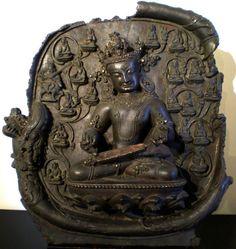 Roundel Depicting   Celestial Musician  Densatil Monastery, Tibet 15th century cast bronze inlaid with semi-precious stones