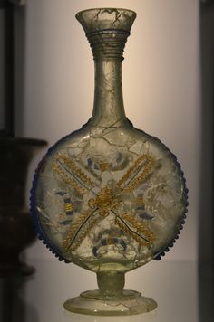 Roman glass bottle decorated with white, blue and gilded snake-threads, Museum het Valkhof, Nijmegen (Netherlands). by Following Hadrian, Flickr