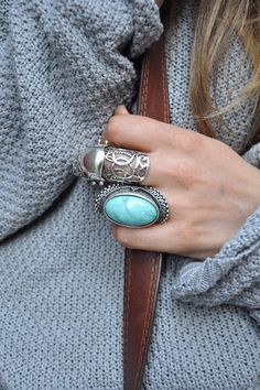 """Maybe not quite so much """"bling!""""  Love the baggy grey sweater and the leather bag strap!"""