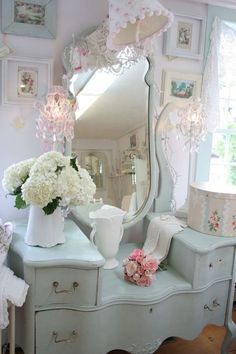 This is a beautiful makeup table! It looks overcrowded but I have to say, the white flowers look really nice sitting on the table!