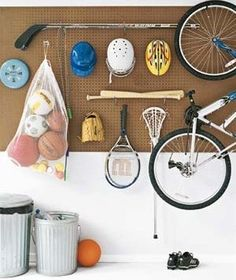 "Buy a pegboard with holes. It will hold more weight than other sizes. For set up tips, see Real Simple's ""Use a Pegboard for Sports Equipment Storage"" Organisation Hacks, Garage Organization, Garage Storage, Storage Spaces, Organizing Ideas, Organizing Solutions, Organized Garage, Storage Ideas, Pegboard Garage"