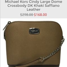 Michael Kors Cindy Large Dome Crossbody DK Khaki Michael Kors Cindy Large Dome Crossbody DK Khaki Saffiano Leather  Compact saffiano leather cross-body bag with polished hardware Zippered top closure with Michael Kors license plate logo on front Michael Kors logo print lining with open slip pocket Single adjustable chain and leather shoulder / cross-body strap with a drop of 19 inches Measures approximately 9 inches (L) x 7 inches (H) x 3.5 inches (W) Michael Kors Bags Crossbody Bags