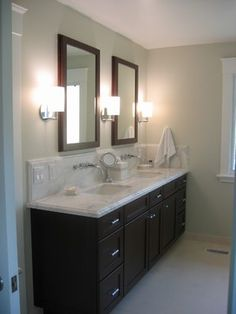 Master Bathroom Dark Cabinets dark cabinets and framed mirrors, light counters, chrome fixtures