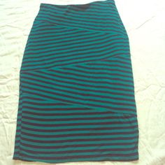 Green and black pencil skirt. Green and black pencil skirt, super comfy, stretch material. Electric waist Mossimo Supply Co Skirts Pencil