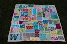 ticker tape quilt inspiration .... love the monogramed w in the corner