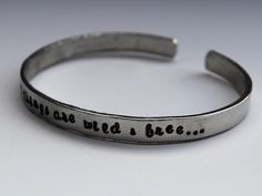 """Cuff with Henry David Thoreau's quote, """"All great things are wild & free..."""" (By GreyElephantJewelry on Etsy)"""