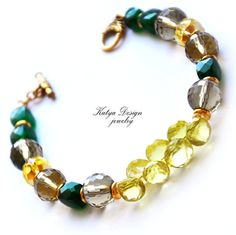 Bracelet lemon topaz, citrine, smoky quartz, and green chrysoprase  $63.00