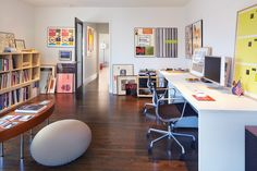 This workspace is both fun and productive, with a lot of room for great ideas.  #office #home Photo Credit: John Sutton Photography