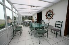 the dining with sea views - the fully winterized conservatory was built in 2011 & conforms with all modern requirements.
