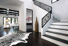 use the railing design for the bottom wainscoting. white on black..