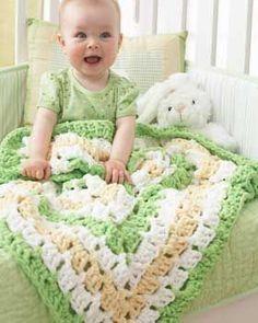 Giant granny square baby blanket in bright fun colors. Shown in Bernat Baby Blanket. Free Pattern.