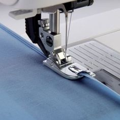Sew a Narrow Hem In One Step. With the Pfaff Narrow Rolled Hem Foot,you can easily stitch rolled hems on blouses, silk scarves or ruffles without pressing the hem first. The rolled hem prevents the fabric edge from fraying and results in a neat, durable Sewing Tools, Sewing Hacks, Sewing Tutorials, Sewing Crafts, Sewing Projects, Sewing Patterns, Stitch Patterns, Techniques Couture, Sewing Techniques