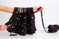 Skip the needles and use your arms to make a scarf.